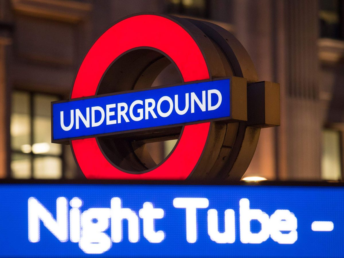 A London Underground roundel alongside an advert for the Night Tube