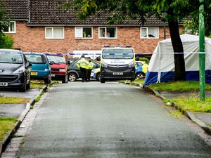 Police at the scene in Wayford Close, Shrewsbury
