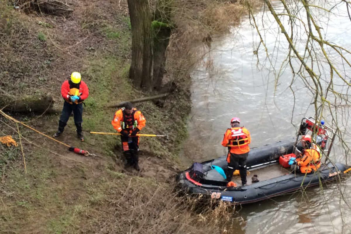 Divers at the scene in Cressage near Shrewsbury