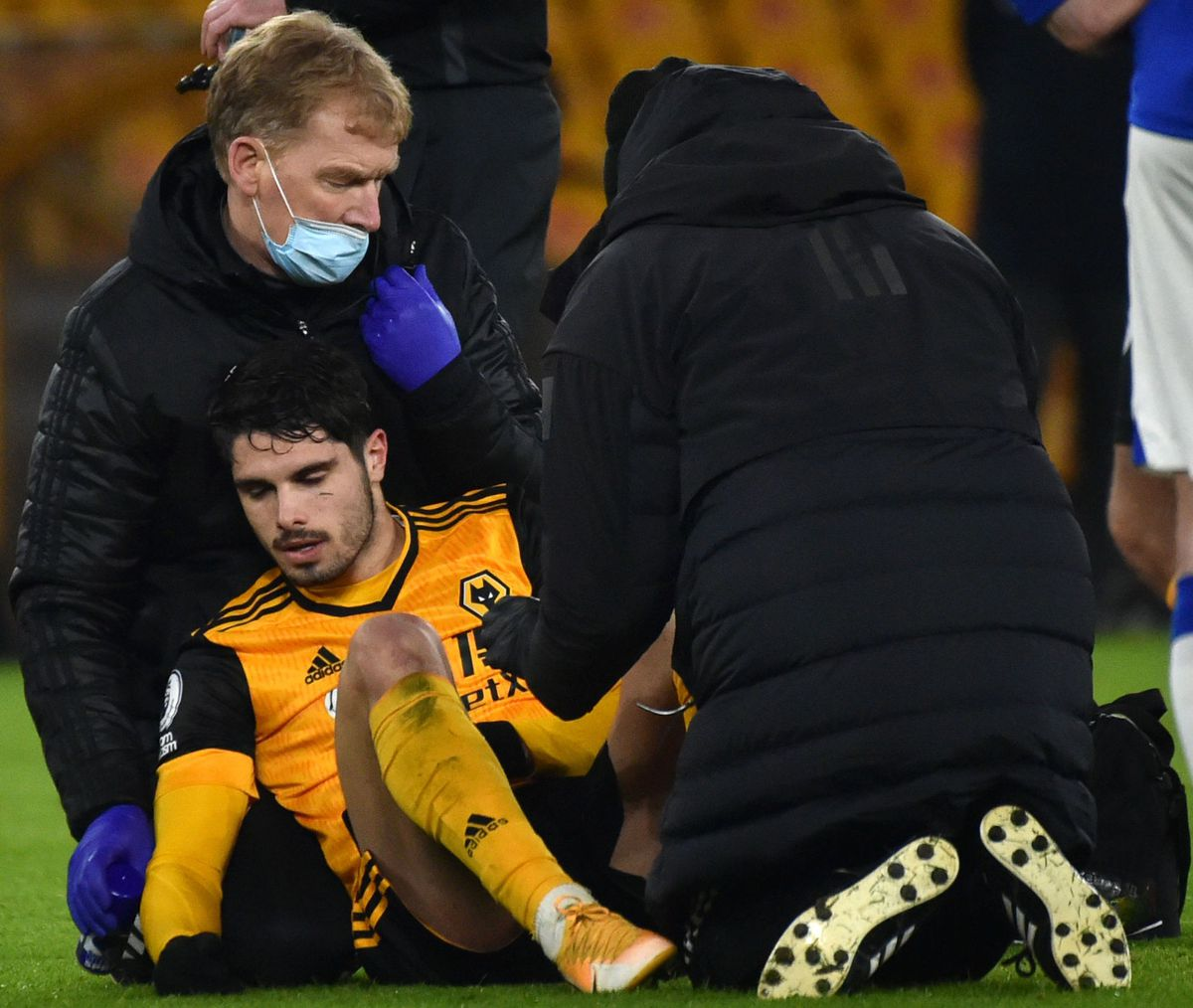 Pedro Neto receives medical treatment during Wolves' defeat to Everton