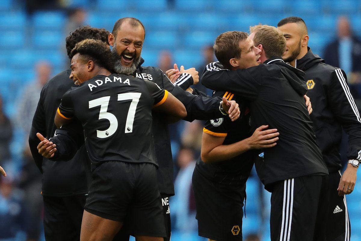 Nuno Espirito Santo the head coach / manager of Wolverhampton Wanderers celebrates victory at the final whistle with Adama Traore (AMA)