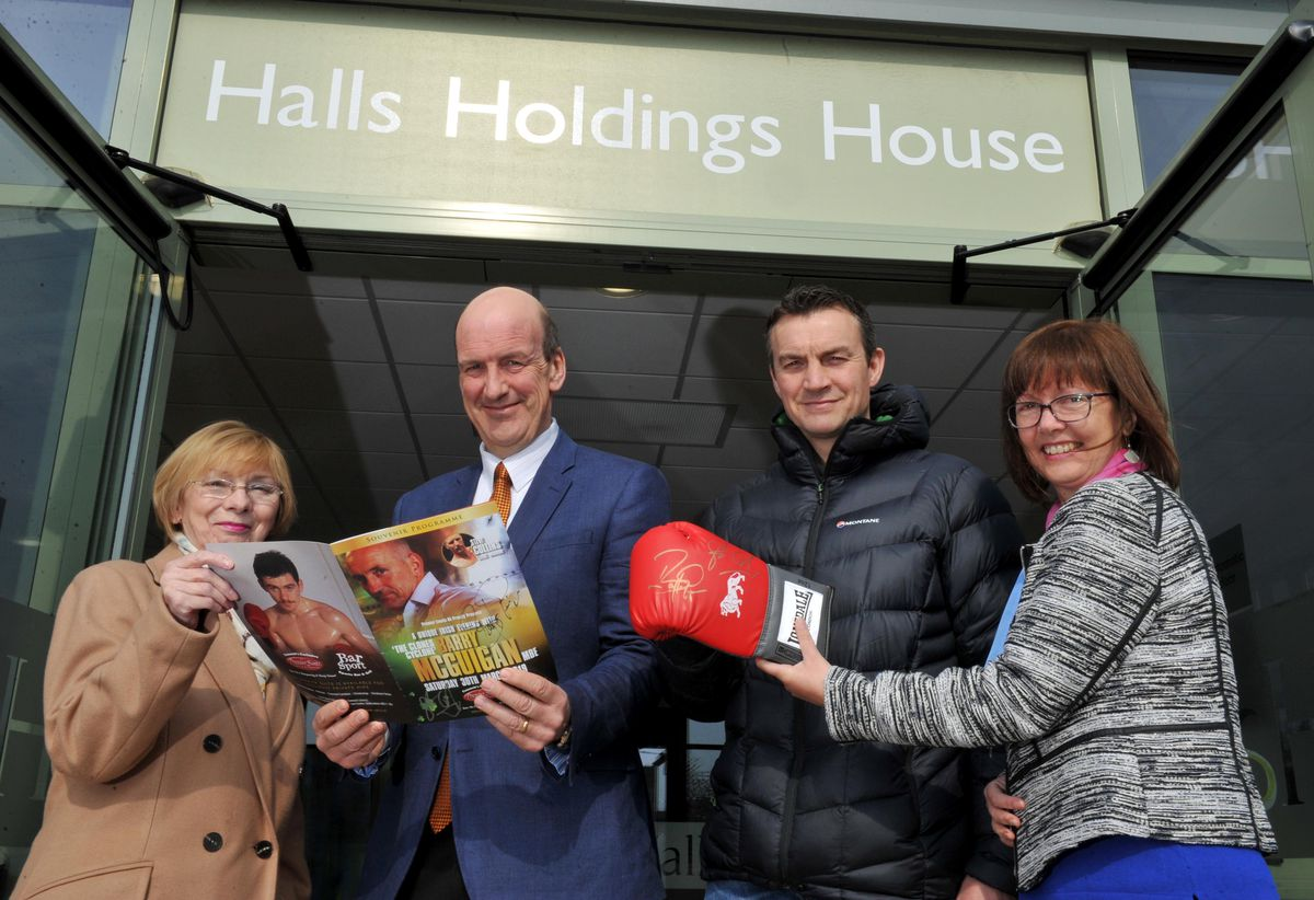 Richie Woodhall (second right) getting ready to auction off a boxing glove and programme signed by Barry McGuigan and Steve Collins. He is pictured with (left to right) Hazel Jackson, of Pink Ribbon Breast Cancer Support, Jeremy Lamond of Halls, and Pink Ribbon chairman Tracey Watkins.