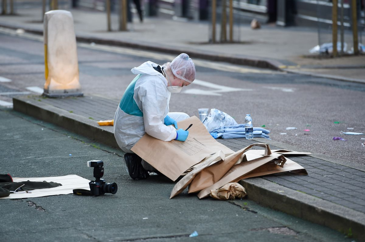 Evidence is put into bags on Hurst Street. Photo: SnapperSK