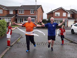 From left, Matt Jones and Matt Price completing their 10K challenge