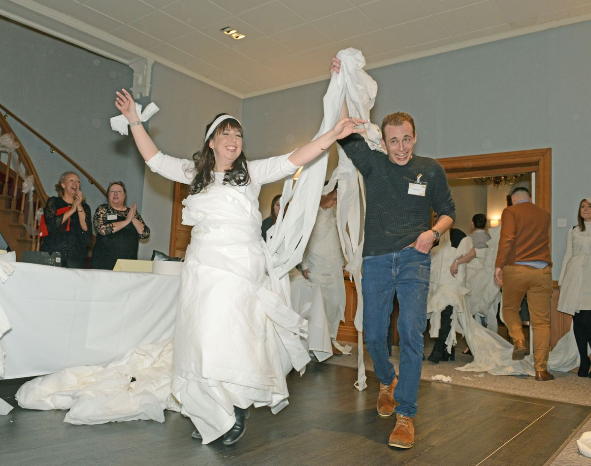 Amy Brookes and Jacob Harris making a wedding dress in one of the challenges
