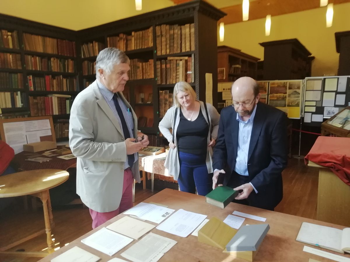 Professor Maddocks views a first edition of Charles Darwin's On the Origin of Species with librarian and archivist Robin Brooke-Smith at Shrewsbury School