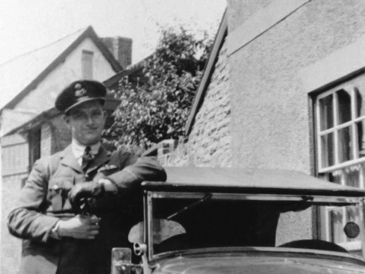 Pilot Officer Hamar home on leave in Knighton, with his bright red Morgan.