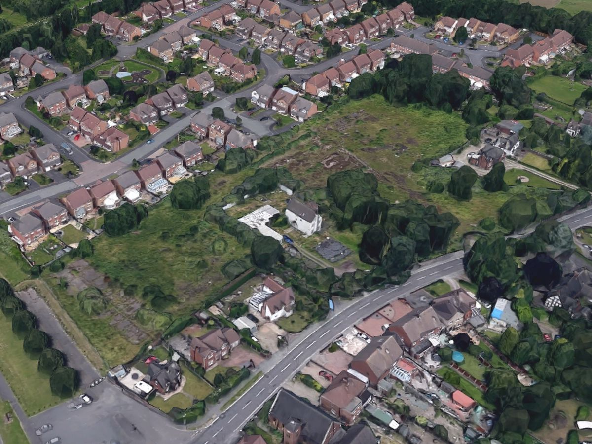An aerial view showing the land where the homes are planned next to Wellington Road. Photo: Google