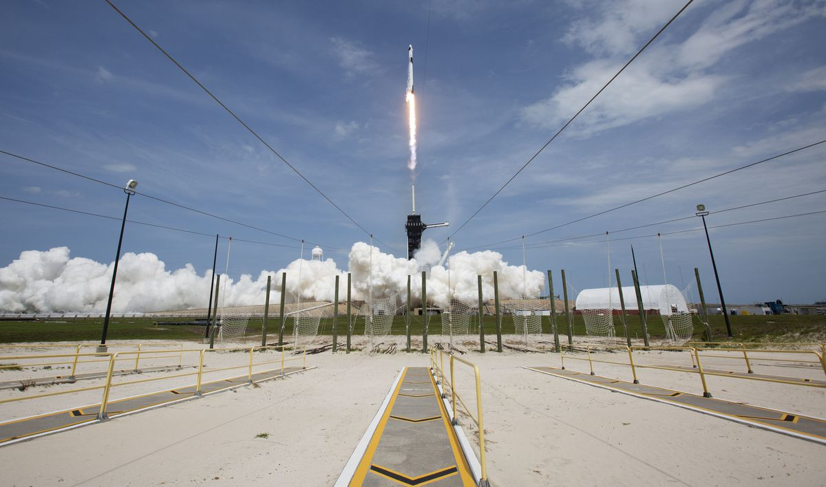 In this photo provided by NASA, a SpaceX Falcon 9 rocket carrying the company's Crew Dragon spacecraft is launched from Launch Complex 39A on NASA's SpaceX Demo-2 mission to the International Space Station with NASA astronauts Robert Behnken and Douglas Hurley onboard, Saturday, May 30, 2020, at NASA's Kennedy Space Center in Cape Canaveral, Florida