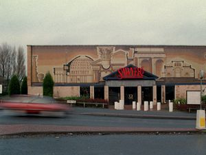 The spectacular ceramic mural on the front of Roman Mosaic tile works, later Sawyers nighclub, was a familiar landmark for many years at Burnt Tree island