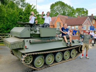 Tanks for the memories! Dad surprises children on school pick-up - in pictures and video