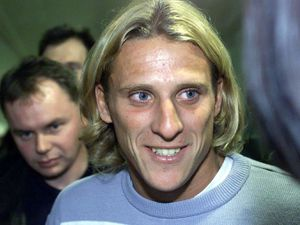 Diego Forlan arrives at Manchester Airport. having opted to join Manchester United ahead of Middlesbrough