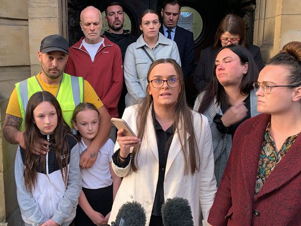 Tia Skelton, centre, the sister of Lewis Skelton, is surrounded by members of their family and solicitor Neil Hudgell, left, as she reads a statement to the media outside Hull Coroner's Court