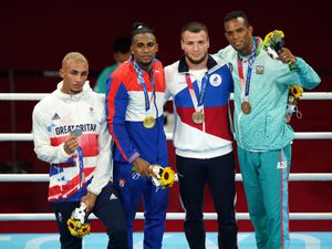 Great Britain's Benjamin Whittaker, silver, Cuba's Arlen Lopez, gold, Russian Olympic Committee's Imam Khataev, bronze, and Azerbaijan's Loren Alfonso, bronze, on the podium for the Men's Light Heavy (75-81kg) Final Bout at Kokugikan Arena on the twelfth day of the Tokyo 2020 Olympic Games in Japan. Picture date: Wednesday August 4, 2021. PA Photo. See PA story OLYMPICS Boxing. Photo credit should read: Mike Egerton/PA Wire.    RESTRICTIONS: Use subject to restrictions. Editorial use only, no  commercial use without prior consent from rights holder.