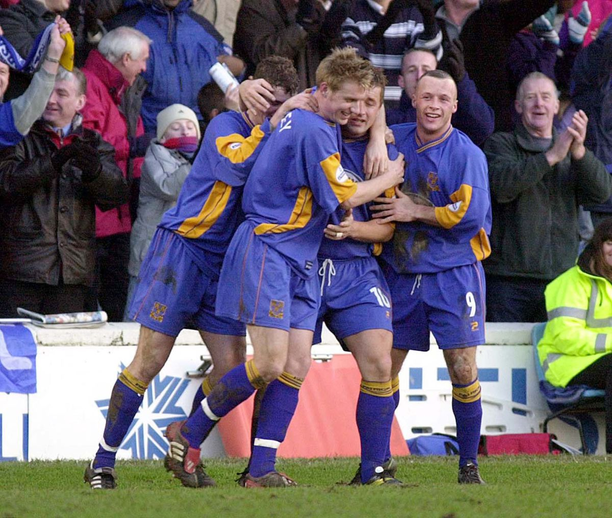 Shrewsbury Town's Nigel Jemson (10) is congratulated by teammates after his free kick goal gives his side the lead against Everton during their FA Cup Third Round match