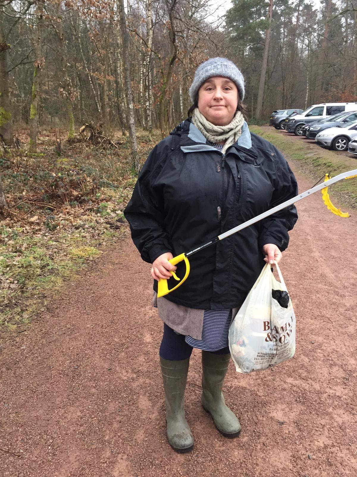 Nancy Brown collects rubbish at Dudmaston