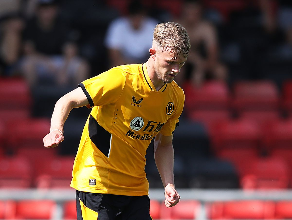 CREWE, ENGLAND - JULY 17: Taylor Perry of Wolverhampton Wanderers runs with the ball during the Pre-Season friendly match between Crewe Alexandra and Wolverhampton Wanderers at Gresty Road on July 17, 2021 in Crewe, England. (Photo by Jack Thomas - WWFC/Wolves via Getty Images).