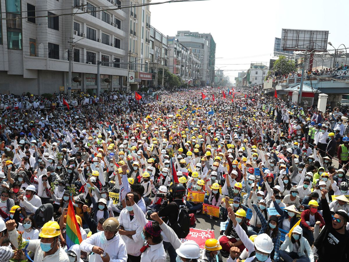 Anti-coup protesters join a rally in Mandalay