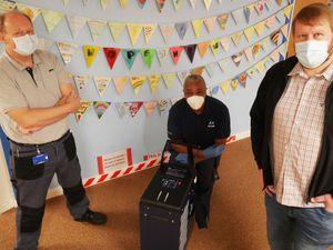 Maintenance staff with the new ozone machine