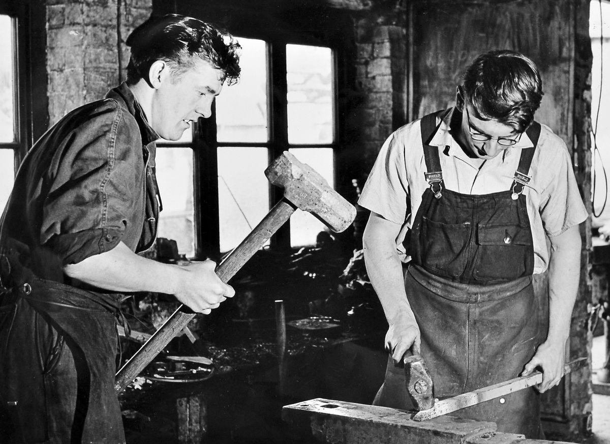 These young blacksmiths were at work in Ellesmere in December 1964. Pictured are D Davies, left, and D E Evans junior at the Cross Street Forge. Mr D E Evans senior had started smithying in 1916 and took over the Cross Street Forge in 1927.