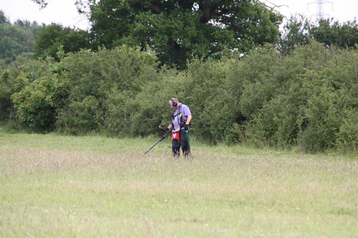 Metal detectorist Steve Heist checks over the field