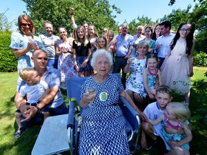Edna Taylor celebrating her 100th birthday with her family