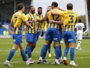 Ryan Bowman of Shrewsbury Town celebrates with his team mates after scoring a goal to make it 1-0.