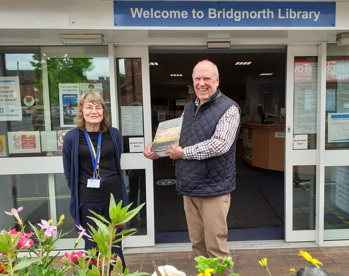 David Oxtoby presenting the book to Anwen Arthur, library assistant in Bridgnorth