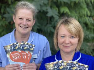 Severn Hospice nurses, Donna Hughes and Pippa Benger, with flyers for the online event.