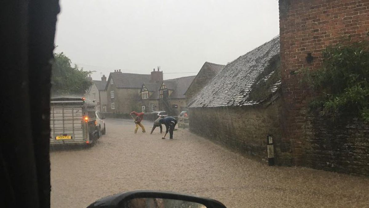 Clearing the drains during heavy rain at Munslow. Photo: Russell Bufton