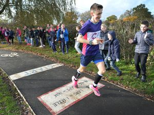 Jack Pickett, 19, has completed his seven marathons in a week challenge for charity. Pictured here doing laps at Criftins, his old primary school. Jack is cheered on by his brother and friends, Tom age 9, who goes to the school and is on the right of the photo