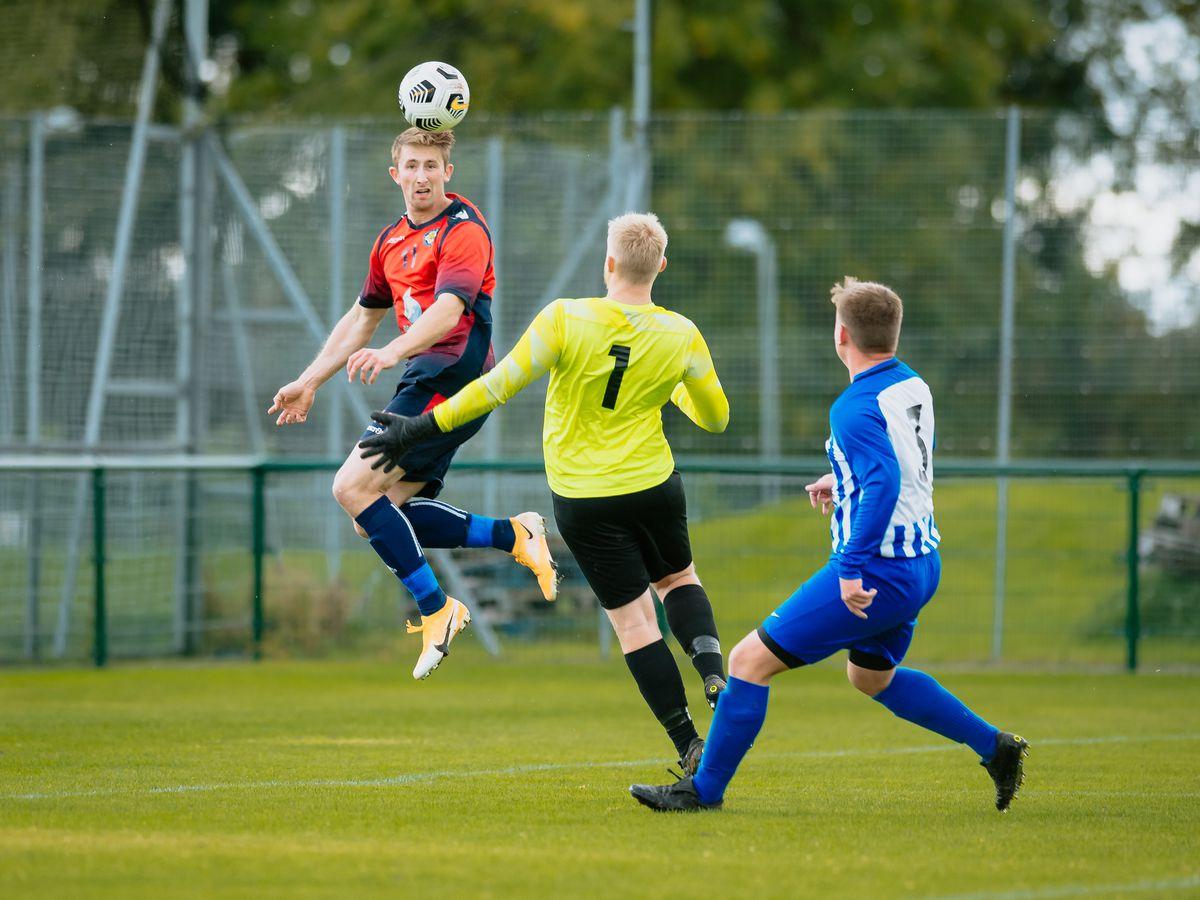 Shrewsbury Juniors (red) vs Steam Wagon (blue) at Shrewsbury Sports Village.