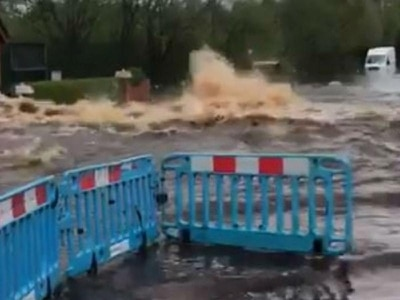 Man hurt after burst water main floods street