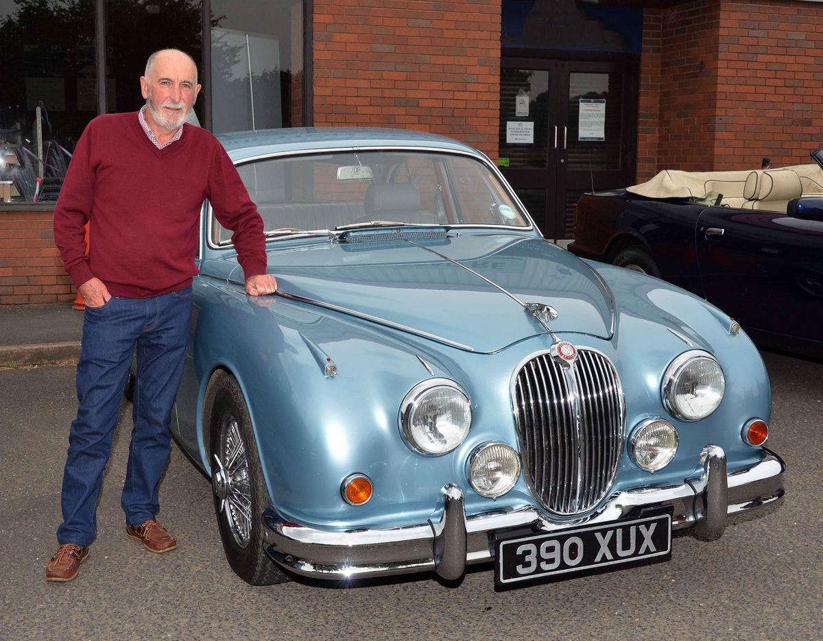 Stuart Husband stands next to his Jaguar 3.8 Mk2