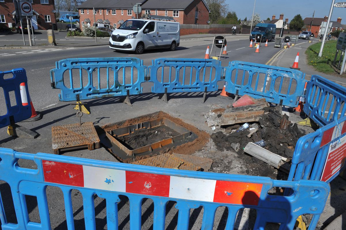 Work to repair a collapsed manhole on the A49 in Bayston Hill