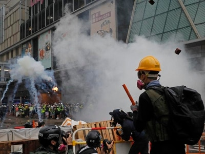 Hong Kong police confirm warning shot fired and 36 arrested