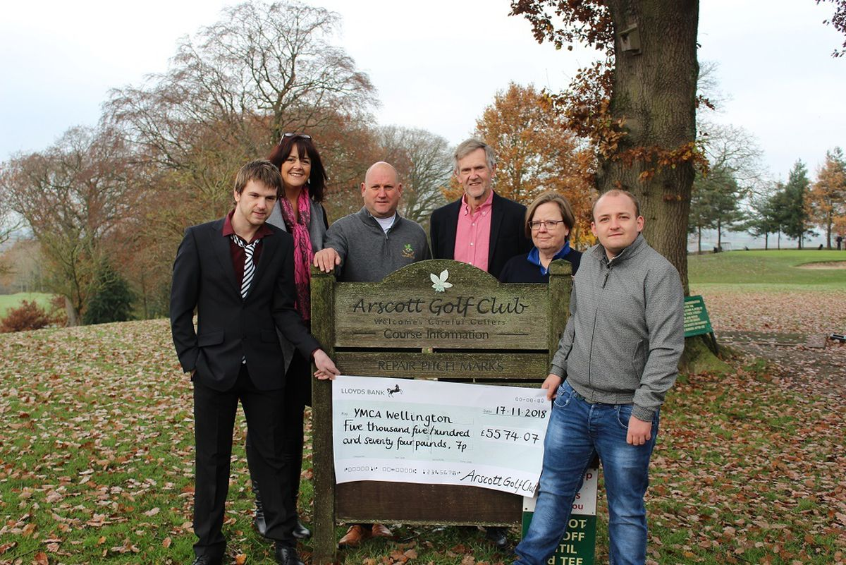 Members of the golf club make their donation