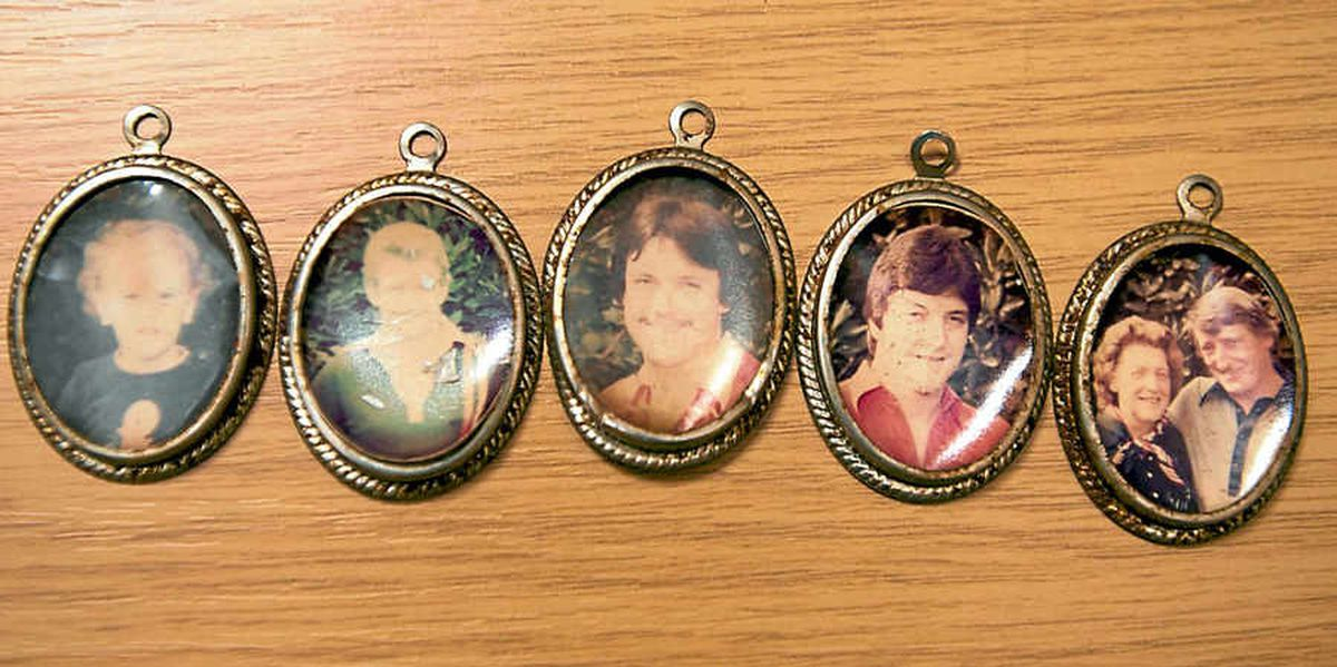 Several pendants featuring family portraits were found in the suitcases