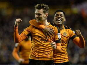 """Wolverhampton Wanderers' Joe Mason celebrates scoring his sides opening goal during the Sky Bet Championship match at Molineux, Wolverhampton. PRESS ASSOCIATION Photo. Picture date: Saturday January 14, 2017. See PA story SOCCER Wolves. Photo credit should read: Simon Galloway/PA Wire. RESTRICTIONS: EDITORIAL USE ONLY No use with unauthorised audio, video, data, fixture lists, club/league logos or """"live"""" services. Online in-match use limited to 75 images, no video emulation. No use in betting, games or single club/league/player publications.."""