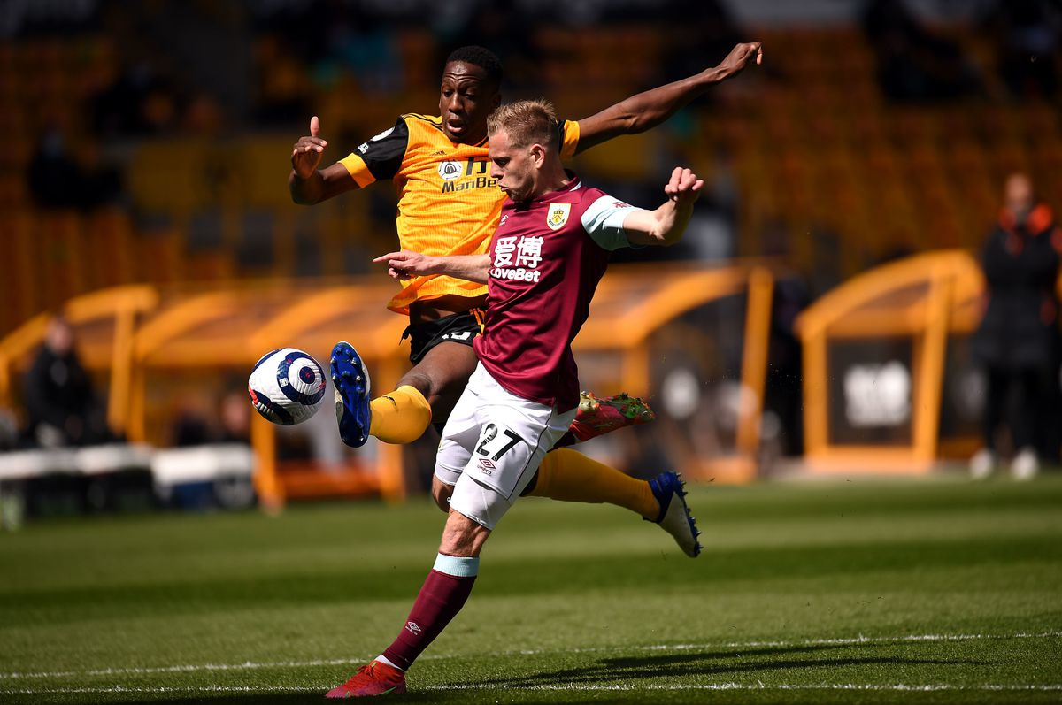 """Wolverhampton Wanderers' Willy Boly (left) and Burnley   s Matej Vydra battle for the ball during the Premier League match at Molineux Stadium, Wolverhampton. Picture date: Sunday April 25, 2021. PA Photo. See PA story SOCCER Wolves. Photo credit should read: Oli Scarff/PA Wire.   RESTRICTIONS:  EDITORIAL USE ONLY No use with unauthorised audio, video, data, fixture lists, club/league logos or """"live"""" services. Online in-match use limited to 120 images, no video emulation. No use in betting, games or single club/league/player publications."""