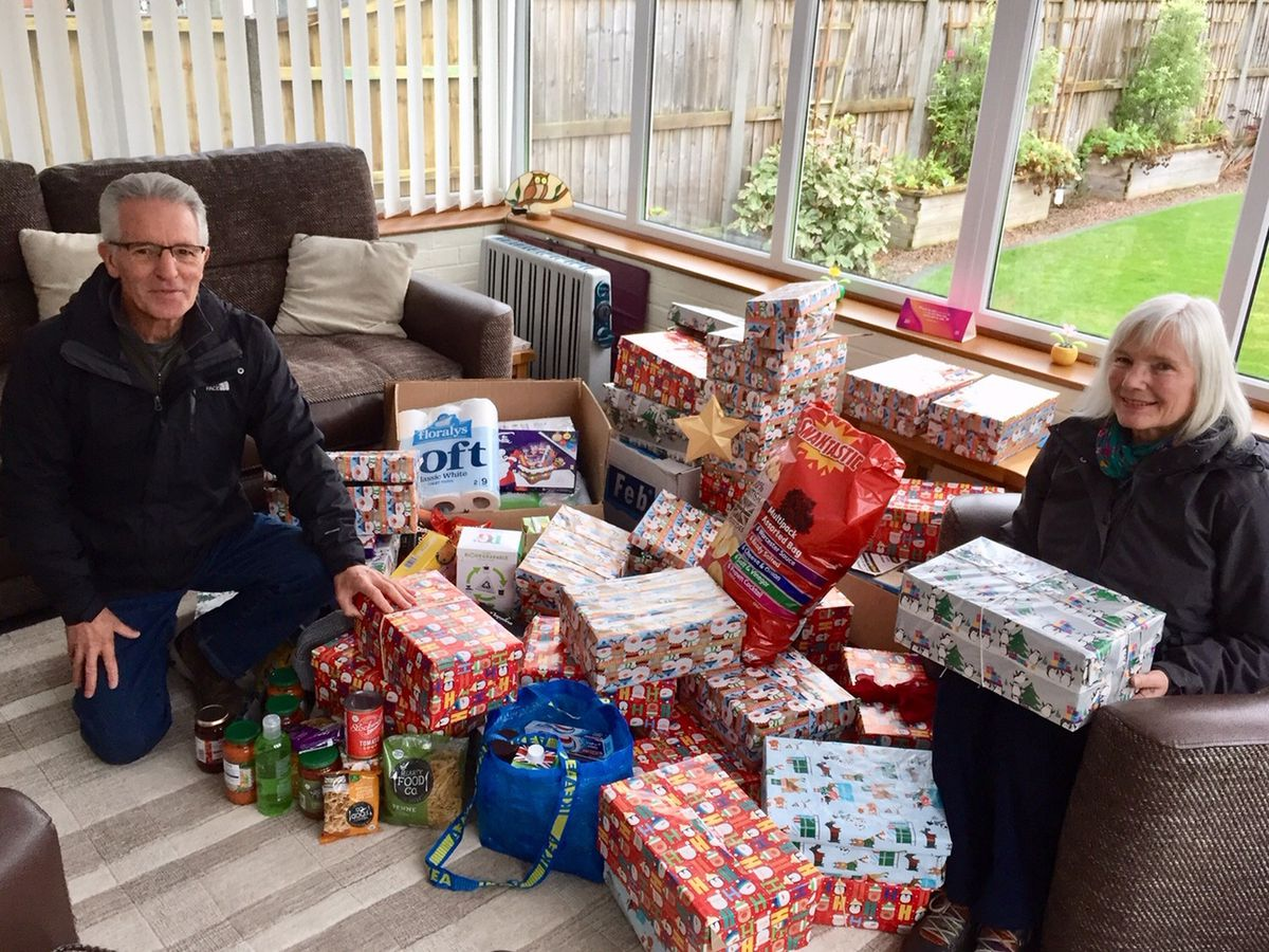 Andrea Lee trustee for Oswestry and Borders food bank with husband David receiving donations.
