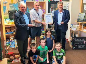 Shropshire Chamber chief executive Richard Sheehan with the overall Chamber Champion award winners, Wrekin View primary school, which has set up a community fridge