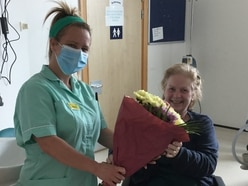 'I owe my life to hospital staff': Sally gets guard of honour after four weeks in a coma