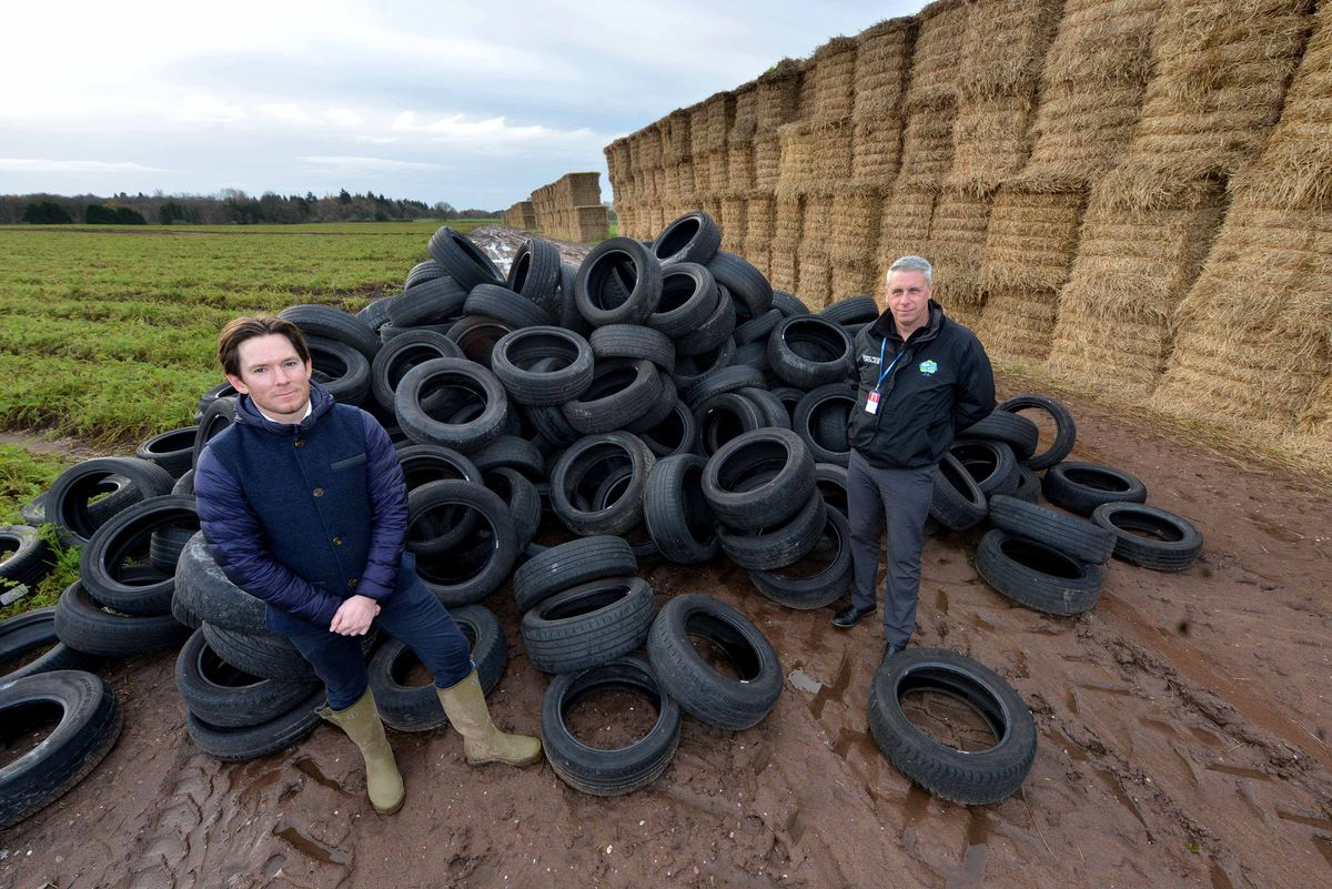 Alexander Newport and Graham Donaldson, West Mercia Police rural and business crime officer, at the site where tyres have been dumped