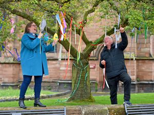 People in Newport have taken to hanging colourful ribbons from trees and railings around the town, and putting up pictures of rainbows. It started with a tree at St. Nicholas Church which is covered in ribbons. Mayor Peter Scott and Reverend Merry Smith marvel at the tree at St Nicholas Church