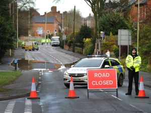 Police shut the road in the aftermath of the crash