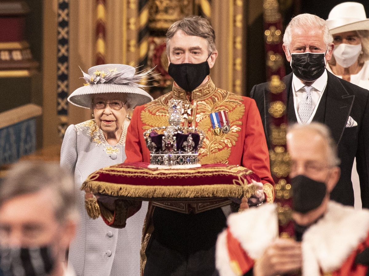 The Queen accompanied by the Prince of Wales