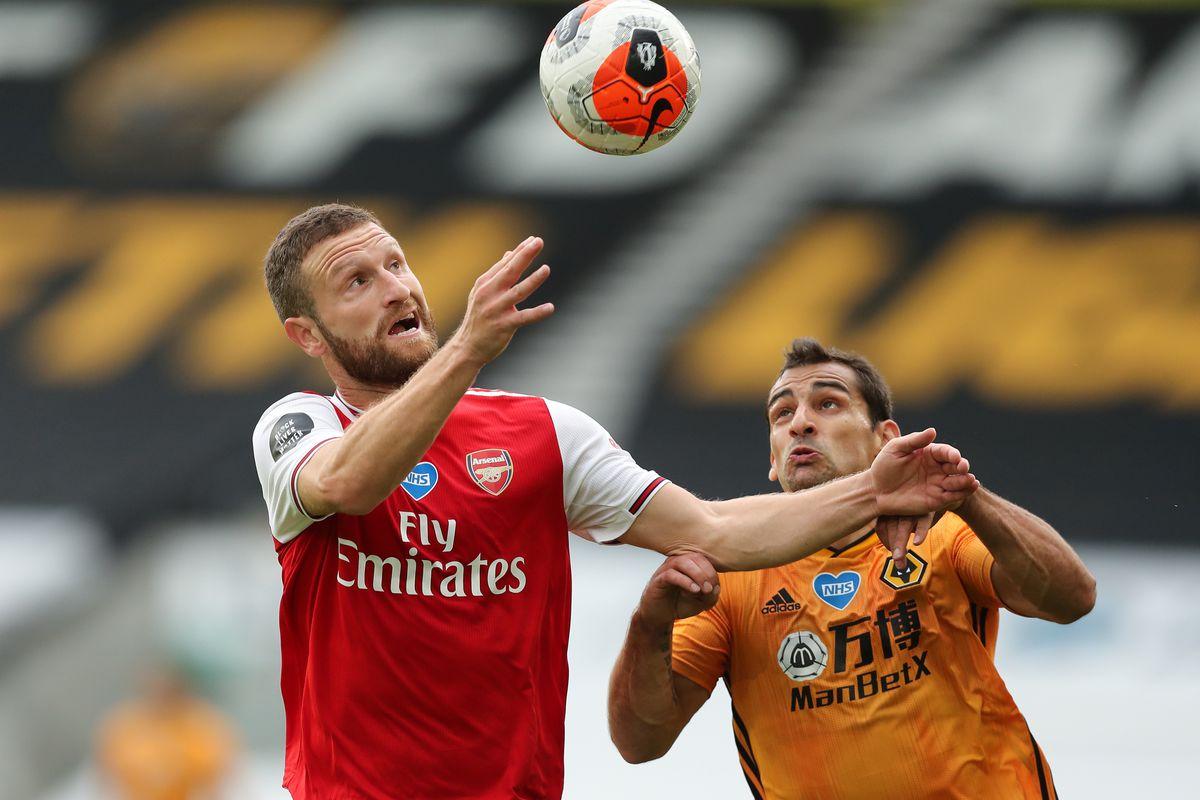 Shkodran Mustafi of Arsenal and Jonny of Wolverhampton Wanderers (AMA)