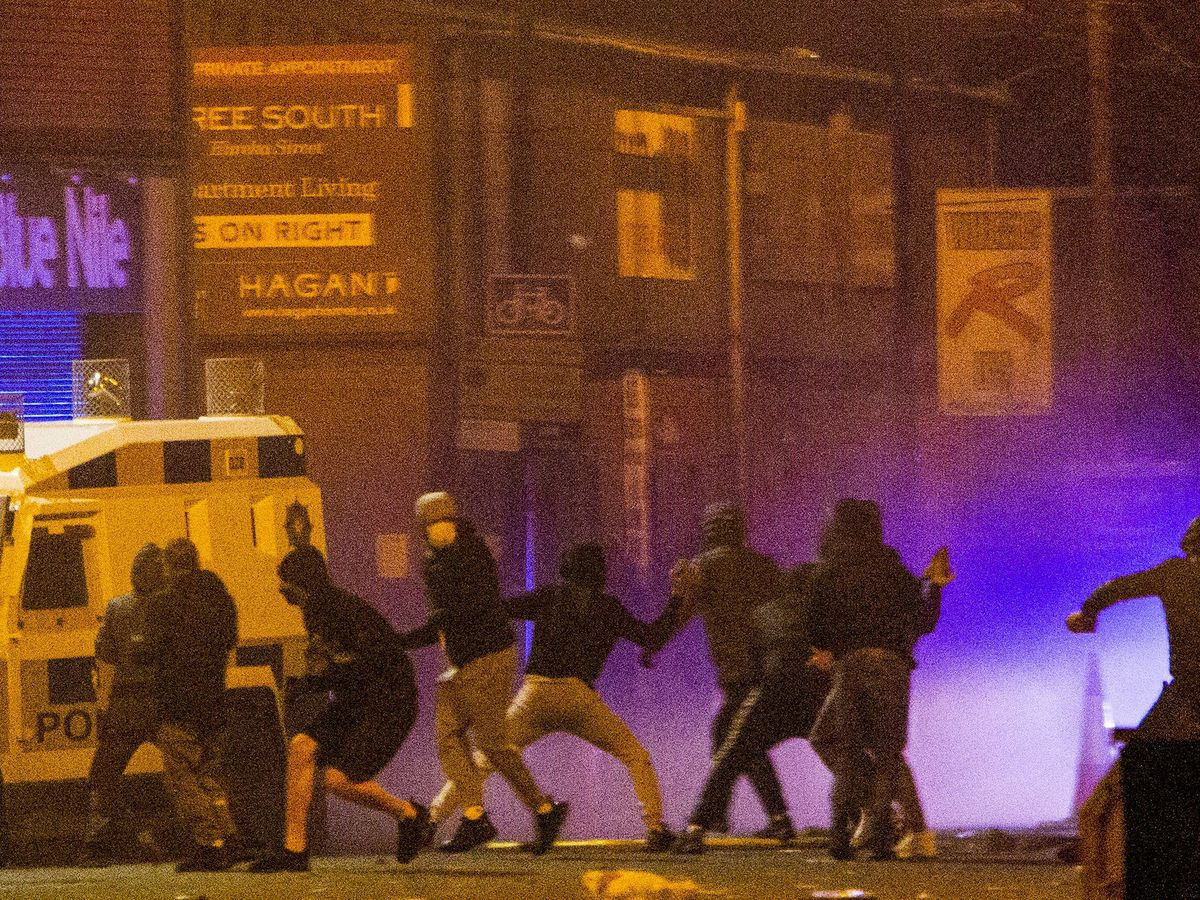 Police in Northern Ireland attacked with petrol bombs and fireworks in Belfast