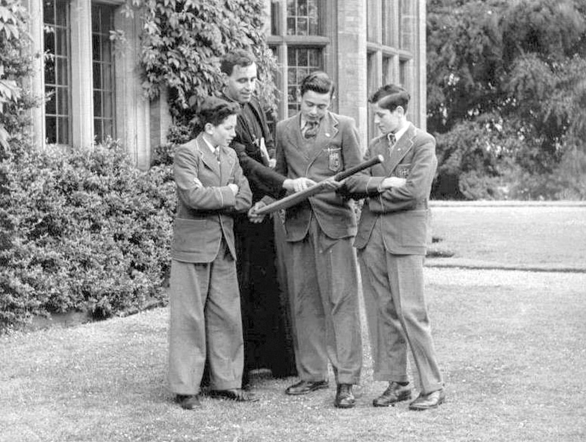 A publicity shot of Brother Philip chatting about cricket with some of the boys.